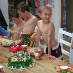 Kyle blowing cake